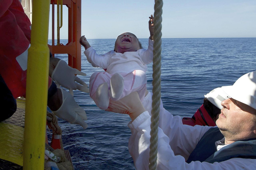 Civil sea rescue in the Mediterranean: Klaus Vogel at the first deployment of SOS MEDITERRANEE. Among the rescued: A three-month-old baby. (Photo: Patrick Bar/SOS MEDITERRANEE)